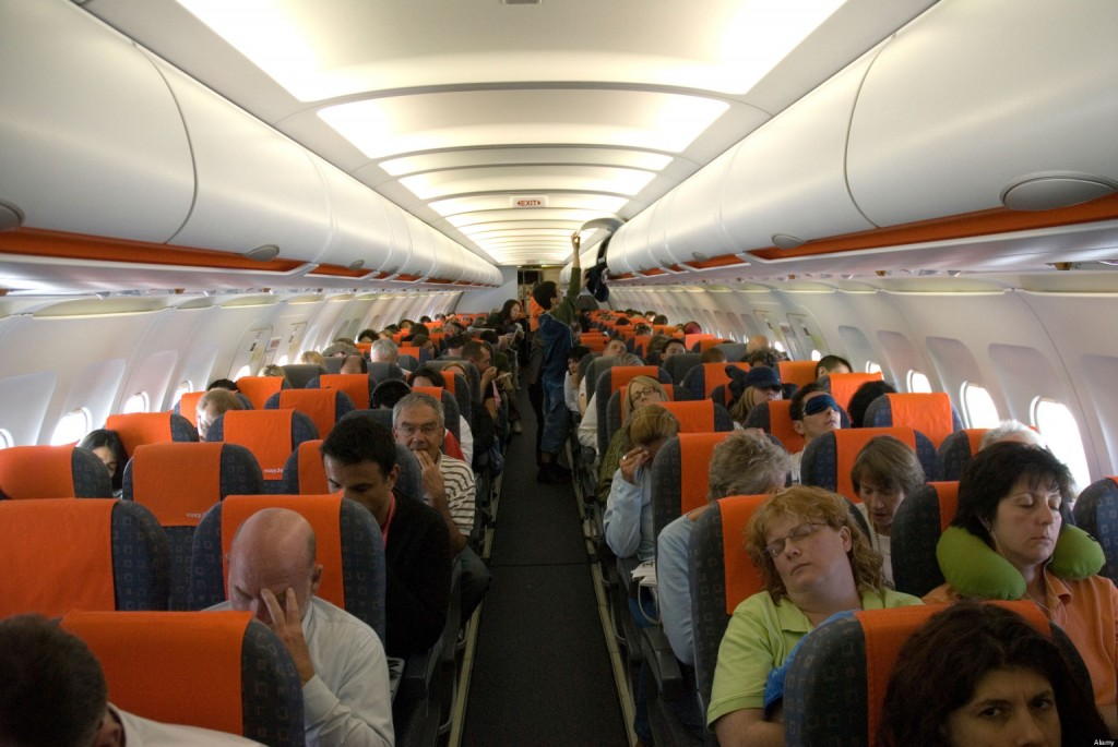 Interior of Easy Jet easyjet plane airplane with passengers seated.